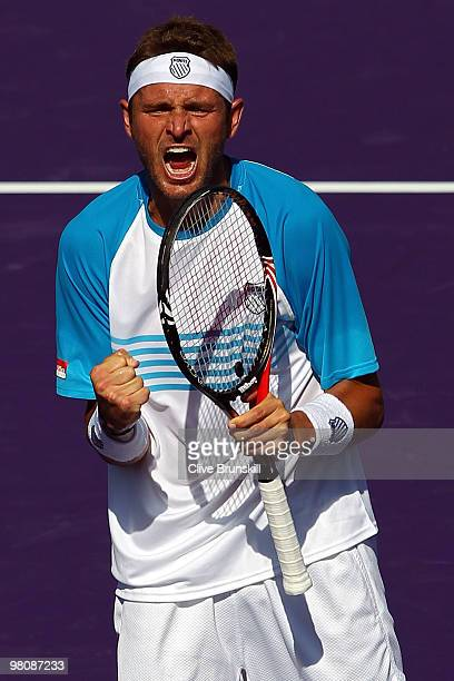 Mardy Fish of the United States reacts after defeating Andy Murray of Great Britain during day five of the 2010 Sony Ericsson Open at Crandon Park...