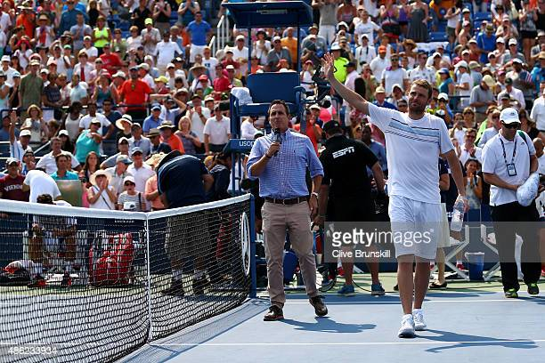 Mardy Fish of the United States waves to the crowd after losing his Men's Singles Second Round match against Feliciano Lopez of Spain on Day Three of...