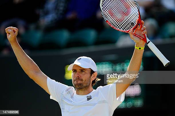 Mardy Fish of the USA celebrates after winning his Gentlemen's Singles third round match against David Goffin of Belgium on day six of the Wimbledon...