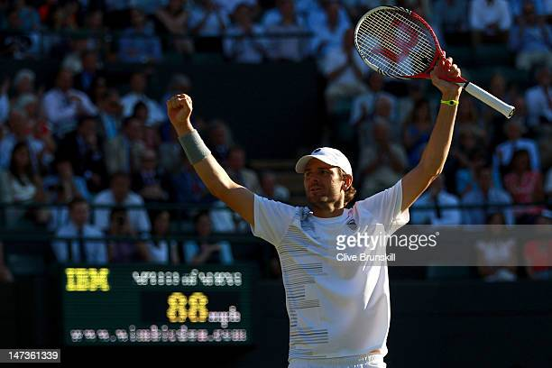 Mardy Fish of the USA celebrates match point during his Gentlemen's Singles second round match against James Ward of Great Britain on day four of the...