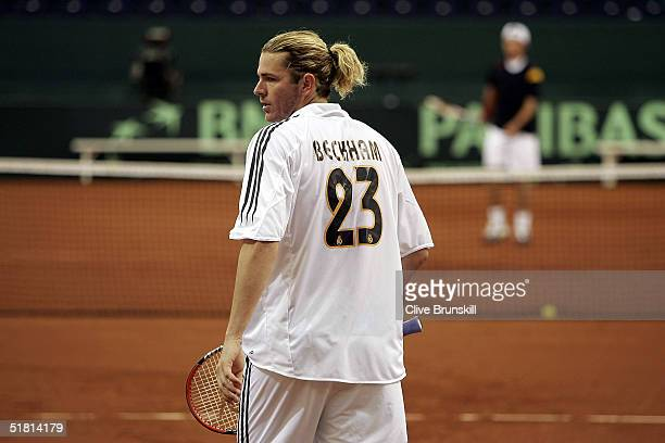 Mardy Fish of the USA practice's in a Real Madrid David Beckham shirt for the Davis Cup by BNP Paribas-World Group Final between Spain and United...