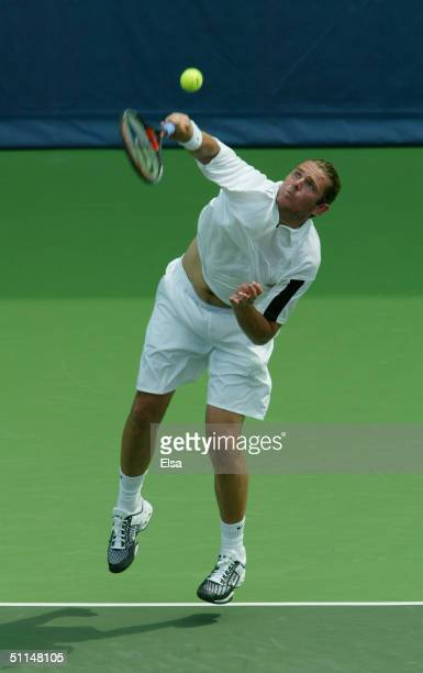 Mardy Fish of the USA returns a shot to Gregory Carraz of France during the RCA Tennis Championships on July 21 2004 at the Indianapolis Tennis...