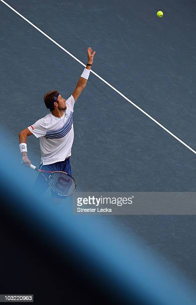 Mardy Fish of the USA serves against Viktor Troicki of Serbia during day 2 of the Legg Mason Tennis Classic at the William H.G. FitzGerald Tennis...