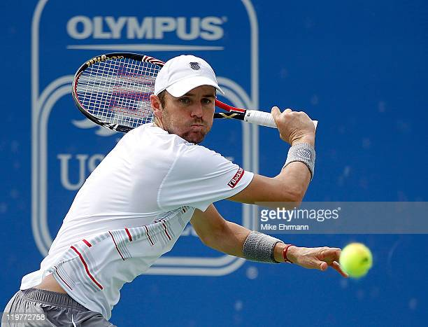 Mardy Fish plays a backhand during the singles final against John Isner at the Atlanta Tennis Championships at the Racquet Club of the South on July...