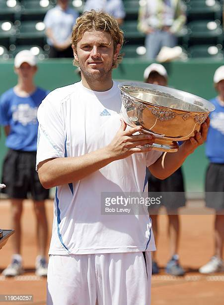 Mardy Fish poses with the trophy after defeating Jurgen Melzer 3-6, 6-4 6-3 to win the U.S. Mens Clay Court Championships on April 16, 2006 at the...