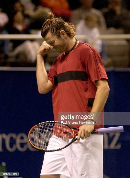 Mardy Fish reacts after missing an opportunity to close out game point in the final set during his match with Andre Agassi at the 2004 Siebel Open in...