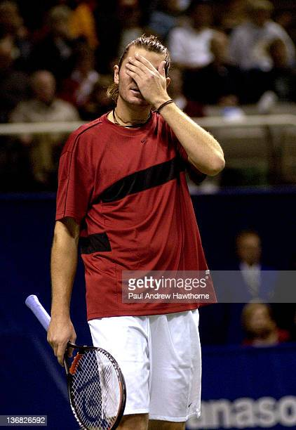 Mardy Fish reacts to the pressure in his match against Andre Agassi at the 2004 Siebel Open in San Jose, California, February 14, 2004. Fish upset...