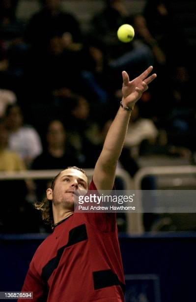 Mardy Fish serves to Andy Roddick during their finals match at the 2004 Siebel Open in San Jose, California, February 15, 2004. Roddick won the...