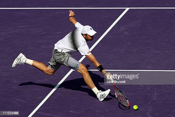 Mardy Fish stretches for a return against David Ferrer of Spain during the Sony Ericsson Open at Crandon Park Tennis Center on March 30 2011 in Key...