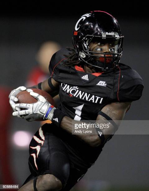 Mardy Gilyard of the Cincinnati Bearcats runs with the ball against the Connecticut Huskies during the Big East Conference game at Nippert Stadium on...