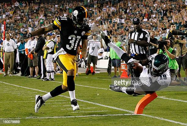 Mardy Gilyard of the Philadelphia Eagles dives in for a touchdown in front of Curtis Brown of the Pittsburgh Steelers during a preseason game at...