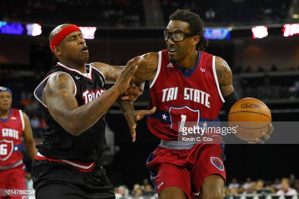 A'mare Stoudemire of TriState drives to the basket against Al Harrington of Trilogy during week eight of the BIG3 three on three basketball league at...