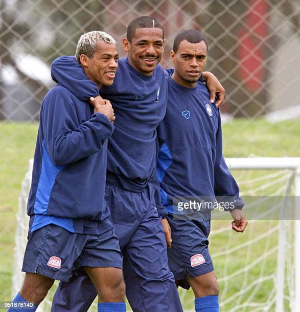 Marecelinho Paraiba Vampeta and Denilson who are all players on the brazilian soccer team 06 October 2001 during practice in the Central Athletic...