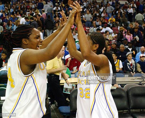 Mareesha Lynch and Janine Jackson of Oakland Tech exchange high fives after the CIF State Division I Girls Basketball final against Canyon Springs at...