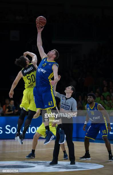 Marei Assem of medi bayreuth and Qvale Brian of Oldenburg battle for the ball during the easyCredit BBL match between medi bayreuth and EWE Baskets...