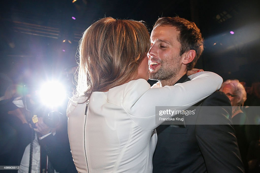 Mareile Hoeppner and her husband Arne Schoenefeld kiss at the Tribute To Bambi 2014 party on September 25, 2014 in Berlin, Germany.