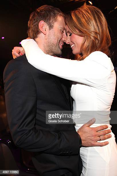 Mareile Hoeppner and her husband Arne Schoenfeld are seen after Tribute To Bambi 2014 show at Station on September 25 2014 in Berlin Germany