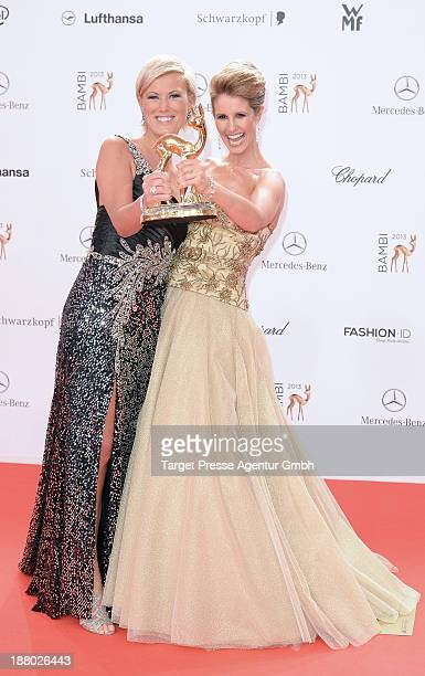 Mareille Hoeppner and Kamilla Senjo pose with the people choice Bambi at the Bambi Awards at Stage Theater on November 14 2013 in Berlin Germany