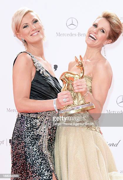 Mareille Hoeppner and Kamilla Senjo pose with the people choice Bambi at Stage Theater on November 14 2013 in Berlin Germany