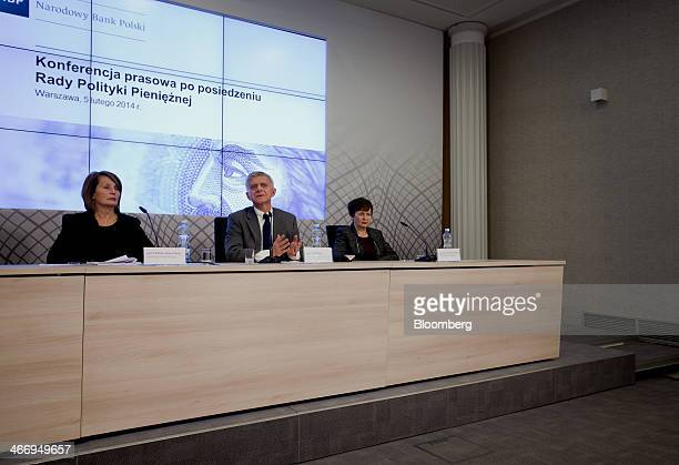 Marek Belka governor of the central bank of Poland center speaks as Elzbieta ChojnaDuch left and Anna ZielinskaGlebocka members of the Financial...
