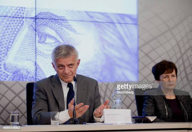 Marek Belka governor of the central bank of Poland left speaks as Anna ZielinskaGlebocka member of the Financial Politics Council listens during a...