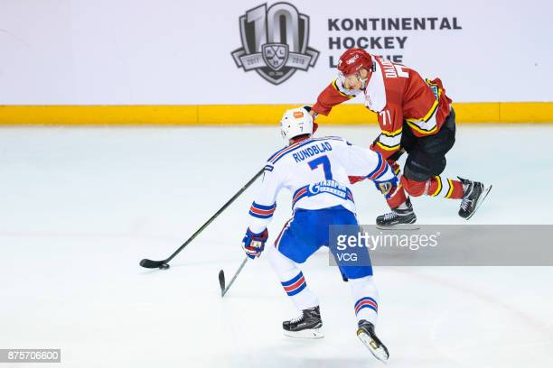 Marek Daloga of HC Kunlun Red Star and David Rundblad of SKA Saint Petersburg vie for the puck during the 2017/18 Kontinental Hockey League Regular...