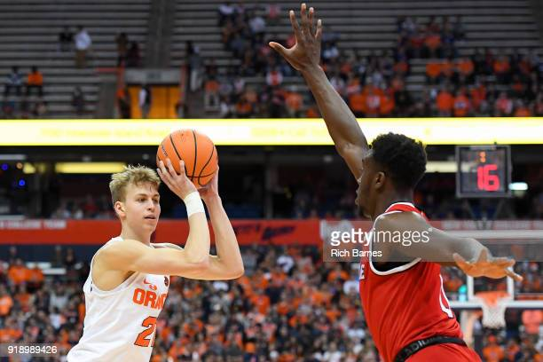 Marek Dolezaj of the Syracuse Orange controls the ball as AbdulMalik Abu of the North Carolina State Wolfpack defends during the first half at the...