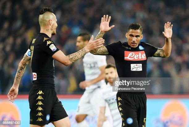Marek Hamsik and Allans of SSC Napoli celebrate the 20 goal scored by Allan during the Serie A match between SSC Napoli and Udinese Calcio at Stadio...