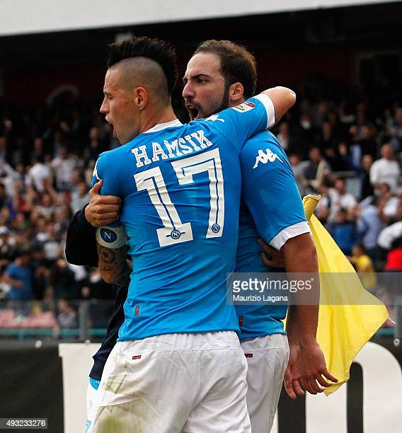 Marek Hamsik and Gonzalo Higuain of Napoli celebrates the winning goal during the Serie A match between SSC Napoli and ACF Fiorentina at Stadio San...