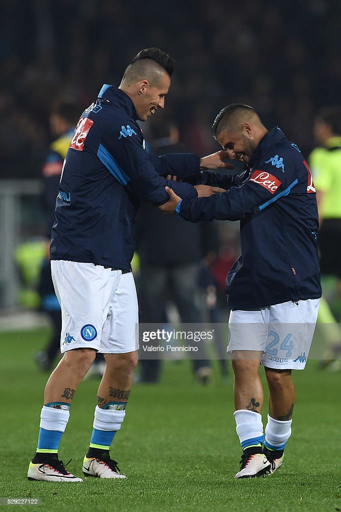 Marek Hamsik (L) and Lorenzo Insigne of SSC Napoli celebrate victory at the end of the Serie A match between Torino FC and SSC Napoli at Stadio Olimpico di Torino on May 8, 2016 in Turin, Italy.