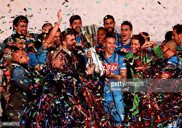 Marek Hamsik Captain of Napoli raises the trophy after winning the 2014 Italian Super Cup match between Juventus FC v SSC Napoli at the Jassim Bin...