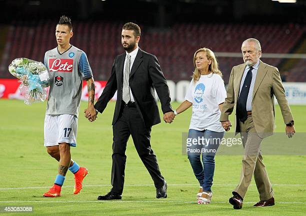 Marek Hamsik, Edoardo De Laurentis, the mother Antonella Leardi and the President Aurelio De Laurentis bring flowers in memory of Ciro Esposito death...