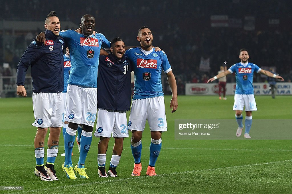 Marek Hamsik, Kalidou Koulibaly, Lorenzo Insigne and Faouzi Ghoulam of SSC Napoli celebrate victory at the end of the Serie A match between Torino FC and SSC Napoli at Stadio Olimpico di Torino on May 8, 2016 in Turin, Italy.