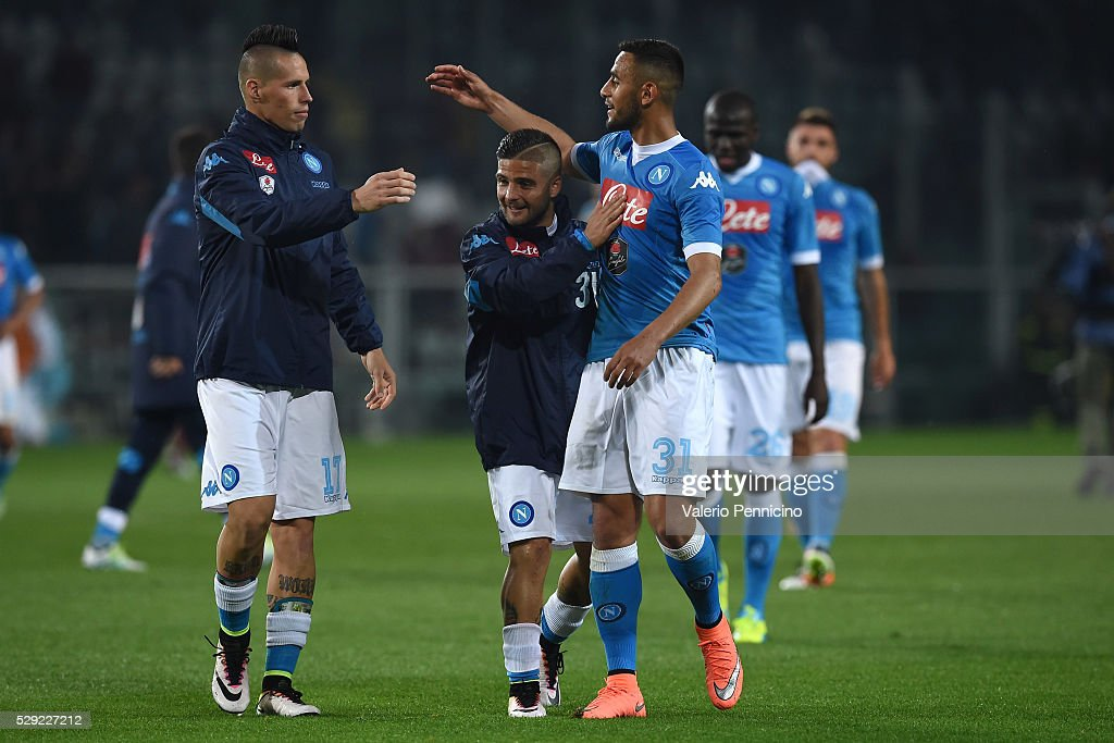Marek Hamsik (L), Lorenzo Insigne (C) and Faouzi Ghoulam of SSC Napoli celebrate victory at the end of the Serie A match between Torino FC and SSC Napoli at Stadio Olimpico di Torino on May 8, 2016 in Turin, Italy.