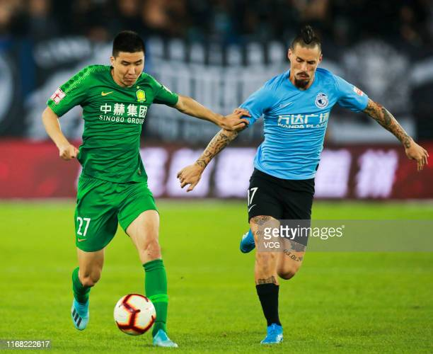 Marek Hamsik of Dalian Yifang and Wang Gang of Beijing Guoan compete for the ball during the 2019 Chinese Football Association Super League 22nd...