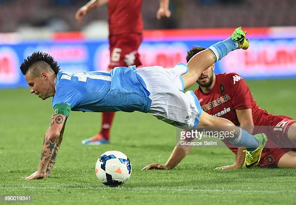 Marek Hamsik of Napoli and Luca Rossettini of Cagliari in action during the Serie A match between SSC Napoli and Cagliari Calcio at Stadio San Paolo...