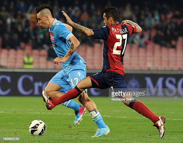 Marek Hamsik of Napoli and Matuzalem of Genoa in action during the Serie A match between SSC Napoli and Genoa CFC at Stadio San Paolo on April 7 2013...