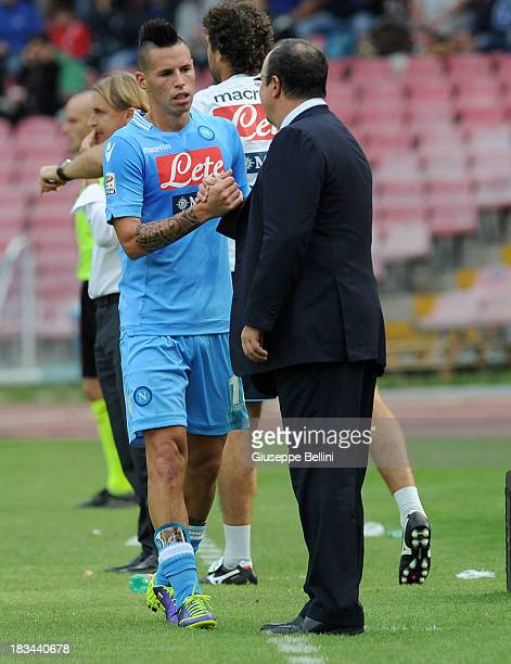 Marek Hamsik of Napoli celebrates with head coach Rafael Benitez after scoring the fourth goal during the Serie A match between SSC Napoli and AS...