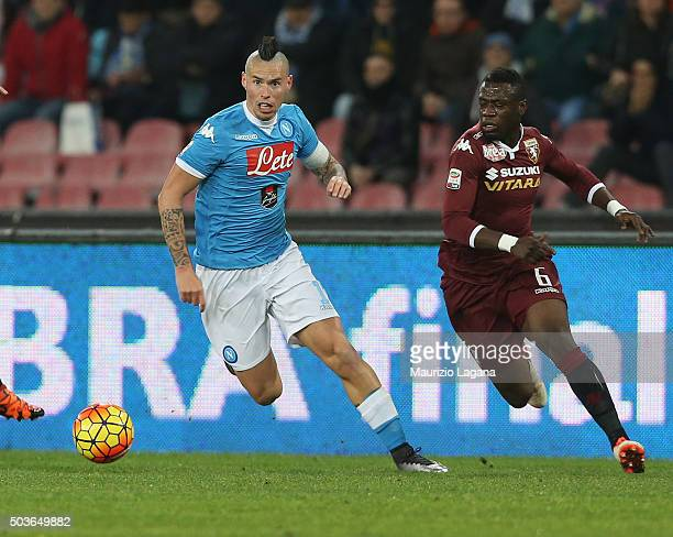 Marek Hamsik of Napoli competes for the ball with Afriyie Acquah of Torino during the Serie A match between SSC Napoli and Torino FC at Stadio San...