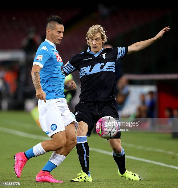 Marek Hamsik of Napoli competes for the ball with Dusan Basta of Lazio during the Serie A match between SSC Napoli and SS Lazio at Stadio San Paolo...