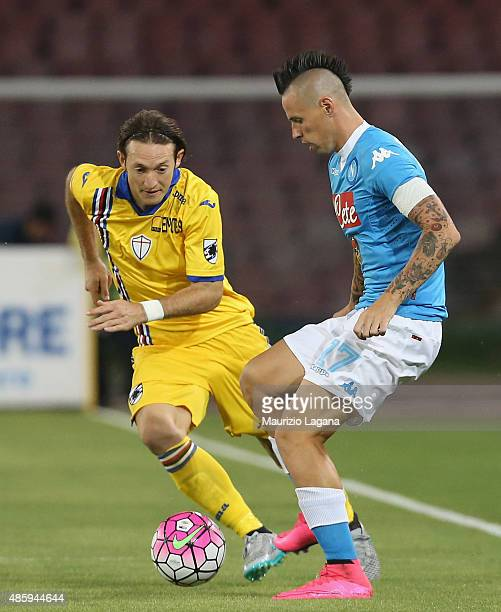 Marek Hamsik of Napoli competes for the ball with Edgar Barreto of Sampdoria during the Serie A match between SSC Napoli and UC Sampdoria at Stadio...