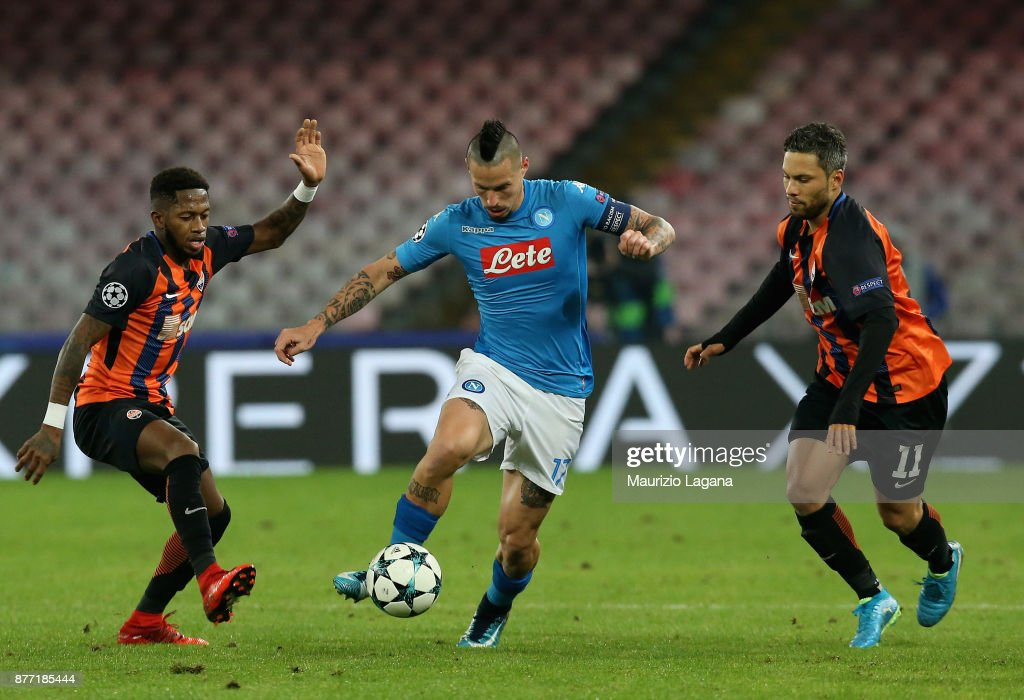 Marek Hamsik (C) of Napoli competes for the ball with Fred (L) and Marlos of Shakhtar Donetsk during the UEFA Champions League group F match between SSC Napoli and Shakhtar Donetsk at Stadio San Paolo on November 21, 2017 in Naples, Italy.