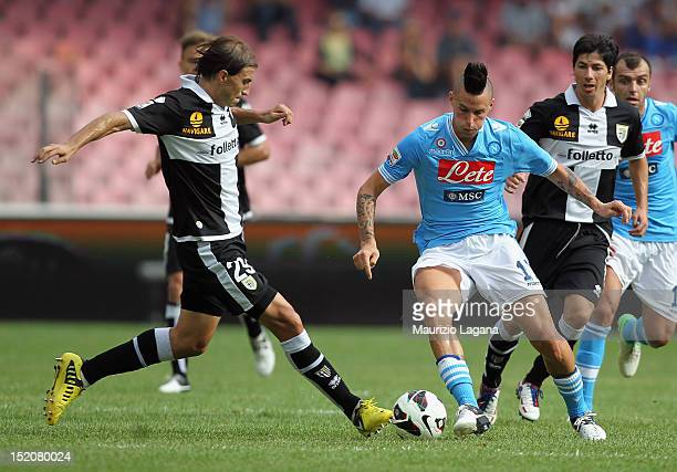 Marek Hamsik of Napoli competes for the ball with Gabriel Paletta of Parma during the Serie A match between SSC Napoli v Parma FC at Stadio San Paolo...