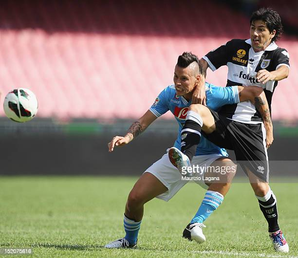 Marek Hamsik of Napoli competes for the ball with Jaime Andres Valdes of Parma during the Serie A match between SSC Napoli and Parma FC at Stadio San...