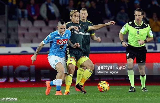 Marek Hamsik of Napoli competes for the ball with Keisuke Honda of Milan during the Serie A between SSC Napoli and AC Milan at Stadio San Paolo on...