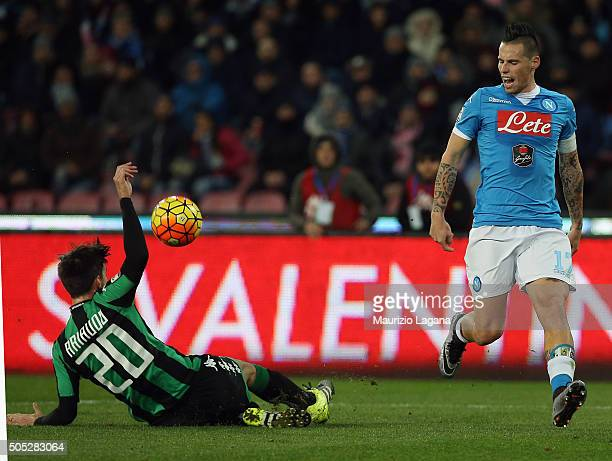 Marek Hamsik of Napoli competes for the ball with Lorenzo Ariaudo of Sassuolo during the Serie A match between SSC Napoli and US Sassuolo Calcio at...