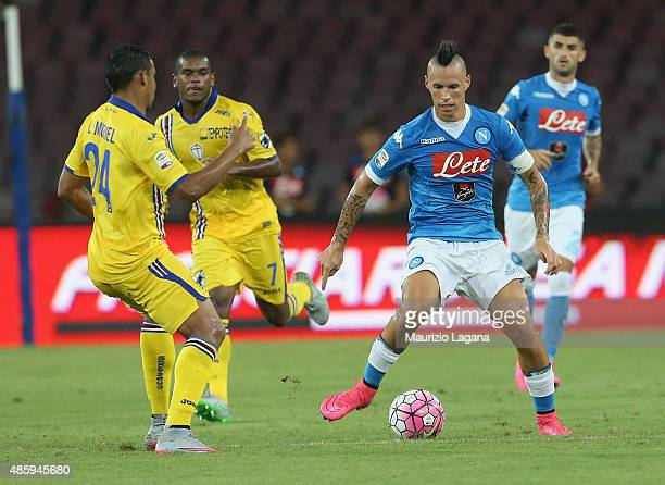 Marek Hamsik of Napoli competes for the ball with Luis Muriel of Sampdoria during the Serie A match between SSC Napoli and UC Sampdoria at Stadio San...
