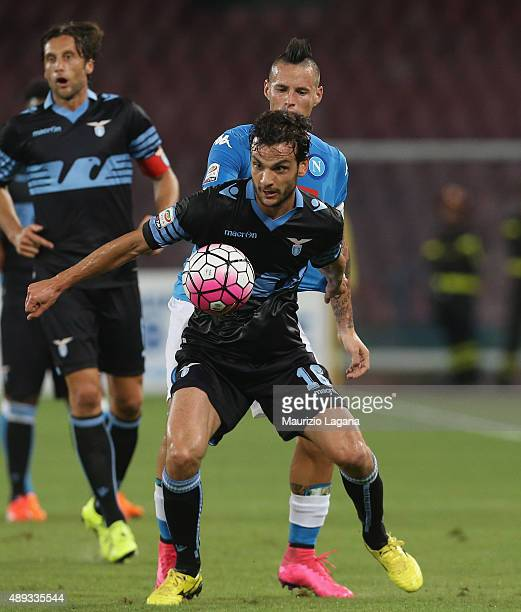Marek Hamsik of Napoli competes for the ball with Marco Parolo of Lazio during the Serie A match between SSC Napoli and SS Lazio at Stadio San Paolo...