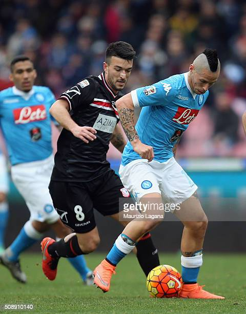 Marek Hamsik of Napoli competes for the ball with Raffaele Bianco of Carpi during the Serie A match between SSC Napoli and Carpi FC at Stadio San...