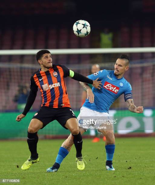 Marek Hamsik of Napoli competes for the ball with Taison of Shakhtar Donetsk during the UEFA Champions League group F match between SSC Napoli and...